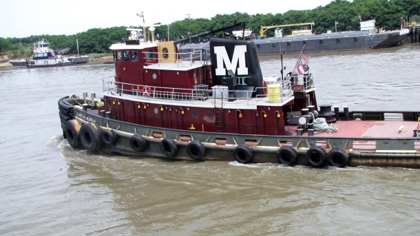Tugboat on the river- Same tug boat company that is used in NYC
